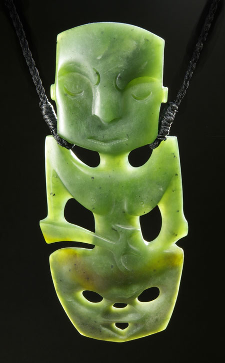 Hand carved NZ jade tiki in upright position.